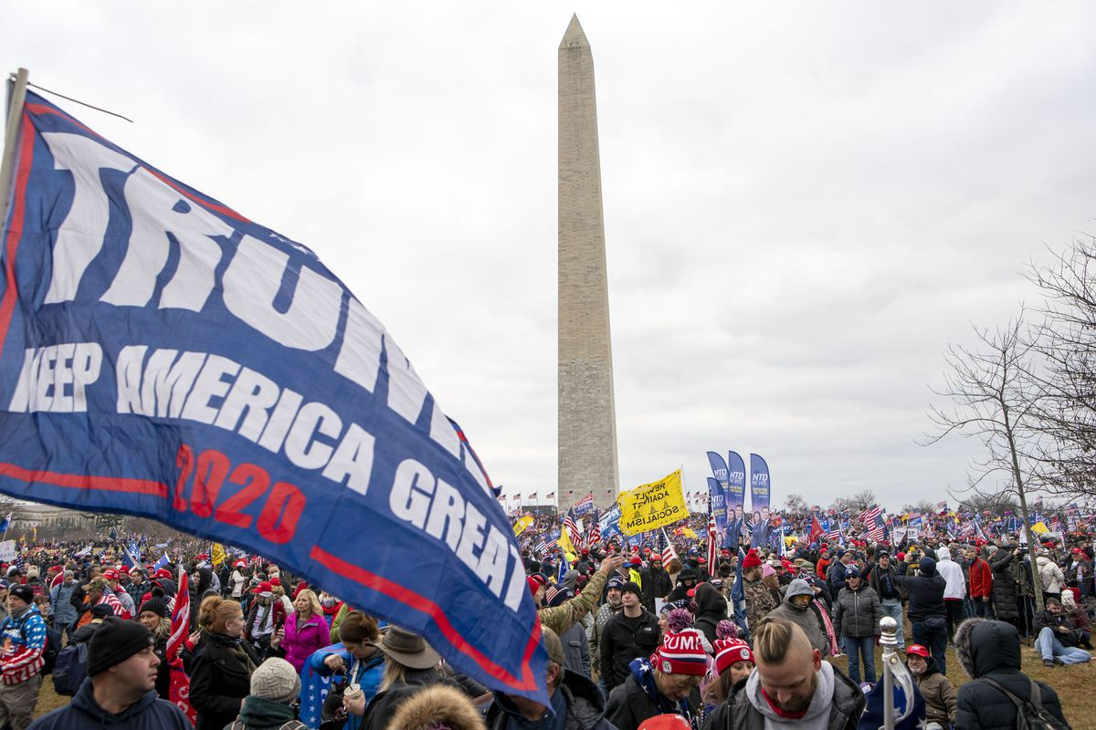 With the Washington Monument in the background, people attend a rally in support of President Donald Trump on Wednesday, Jan. 6, 2021, in Washington