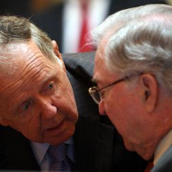 Sen. Charles J. Colgan, D-Prince William, left, who was the only Democrat to vote for the budget bill, talks with Sen. Walter A. Stosch, R-Henrico, chairman of the House Appropriations committee, talk after the budget passed the Senate  at the State Capitol in Richmond, Va. Wednesday, April 18, 2012.