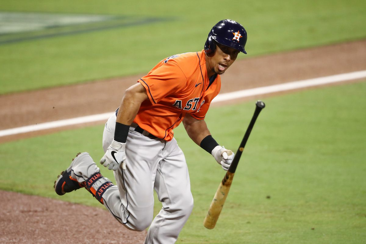 Michael Brantley #23 of the Houston Astros throws his bat while looking at the Tampa Bay Rays dugout while running on a fly out during the third inning in Game Seven of the American League Championship Series at PETCO Park on October 17, 2020 in San Diego, California.