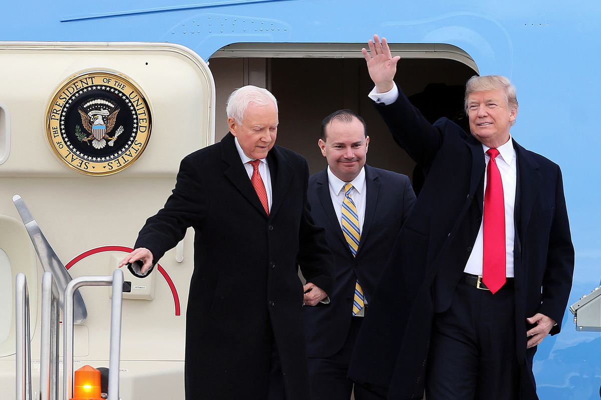 President Donald J. Trump waves to the assembled crowd as he and Sen. Orrin Hatch and Mike Lee arrive in Salt Lake City in 2017. Lee is playing a critical role behind the scenes to get Trump acquitted in his upcoming impeachment trial.