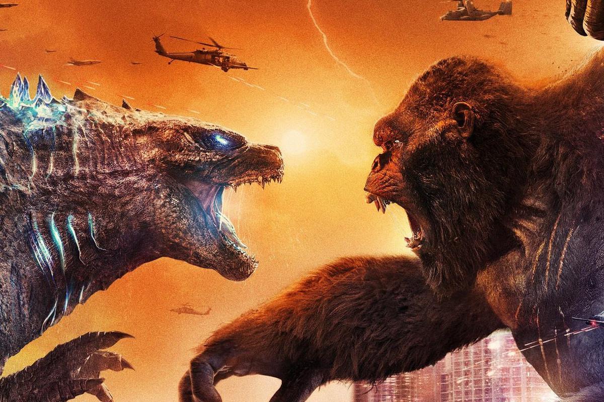 Godzilla and Kong fighting.