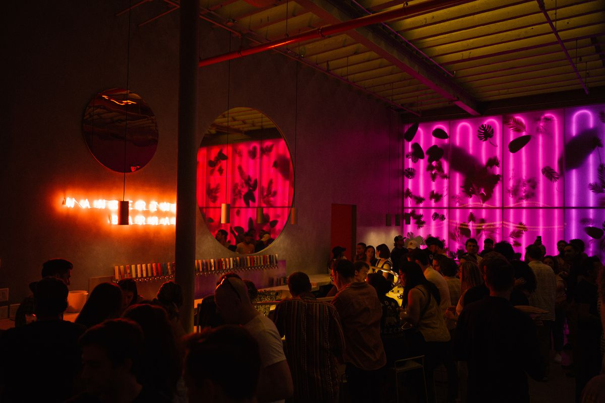 The chic and vibey taproom at Wandering Barman, filled with standing customers