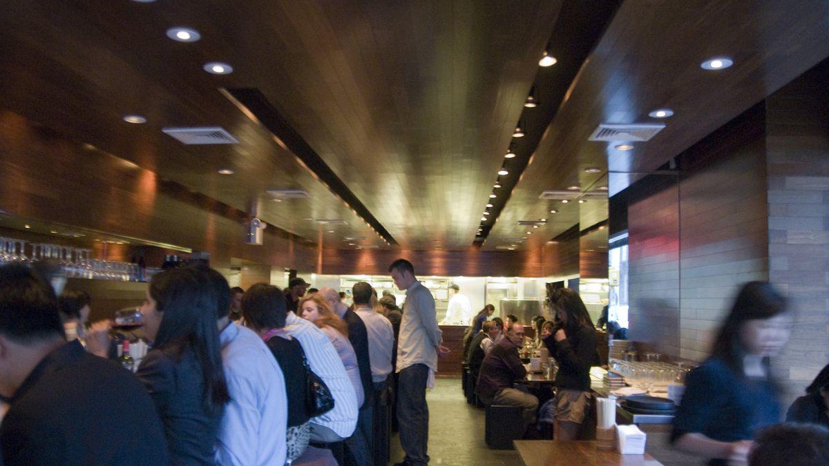 Diners sit at the bar and at tables at Momofuku Ssam Bar