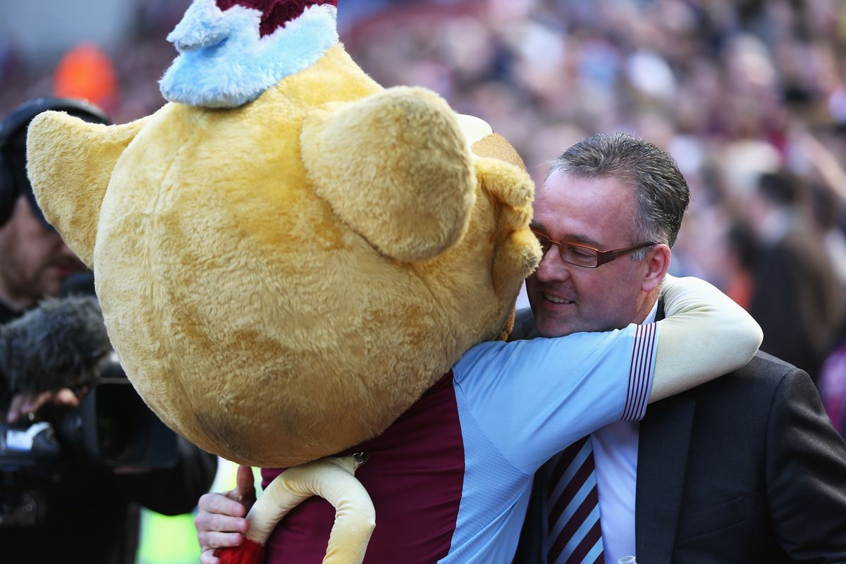 Paul Lambert hugs the mascot after the win over Hull City, but will he be hugging Randy Lerner after hearing how large his transfer budget is?