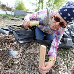 Christina Stanley, collective plots coordinator for Rose Park Community Garden, works at the Rose Park Community Garden in Salt Lake City on Monday, April 17, 2017.