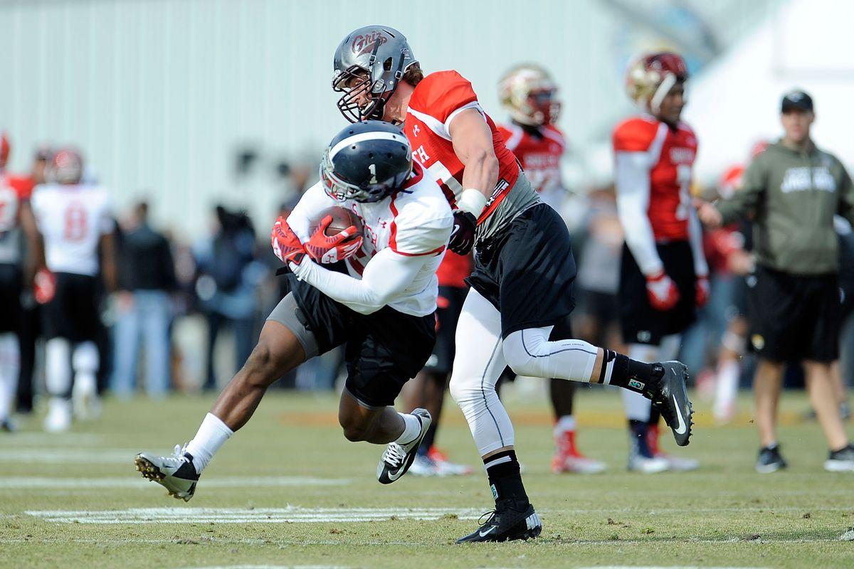 Jordan Tripp makes a tackle during a Senior Bowl workout.
