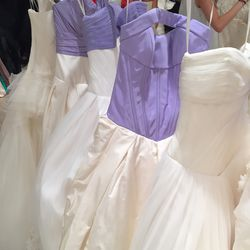Lilac and white gowns, $1,200—$1,700