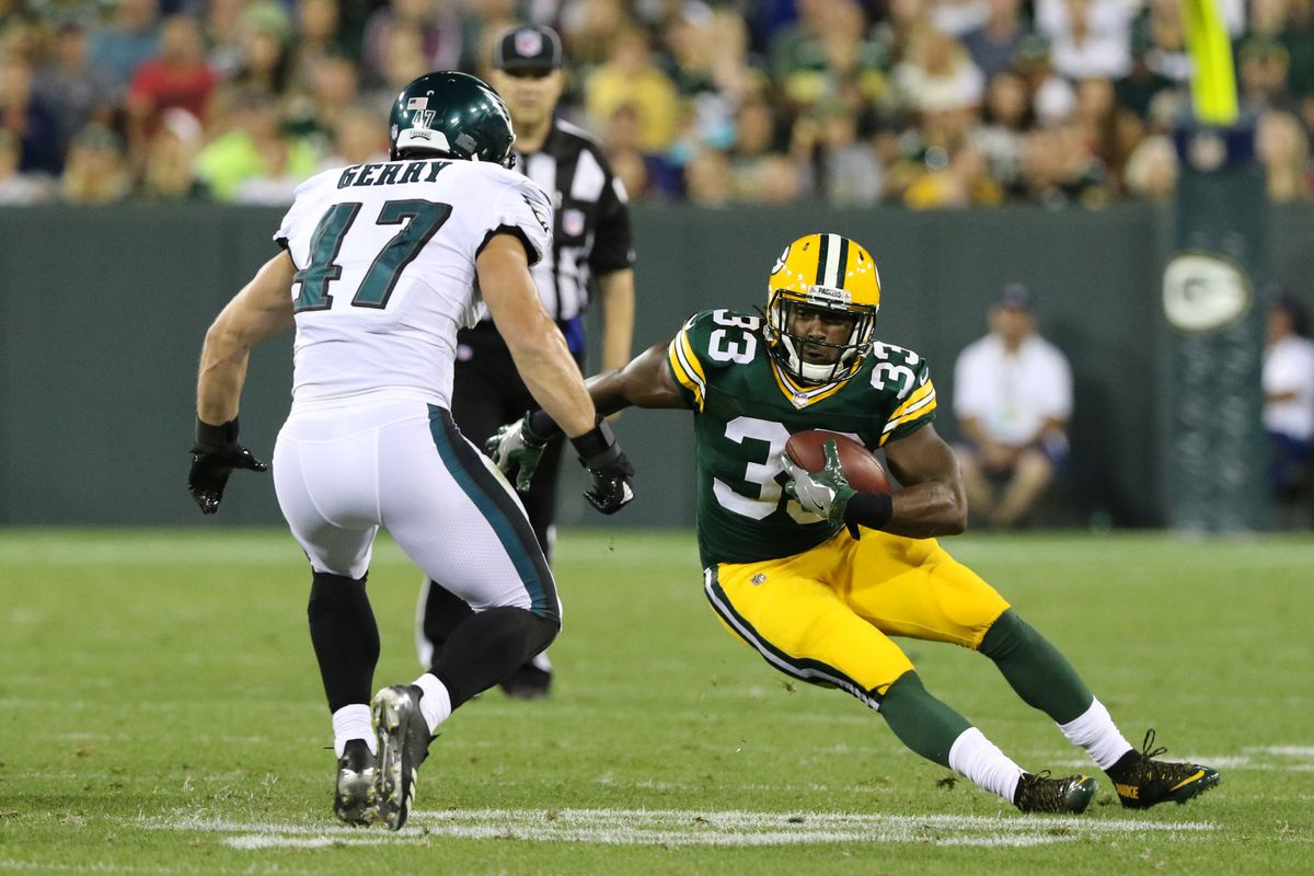 Green Bay Packers running back Aaron Jones tries to evade Philadelphia Eagles linebacker Nate Gerry during a football game between the Green Bay Packers and the Philadelphia Eagles on August 10, 2017, at Lambeau Field in Green Bay, WI.