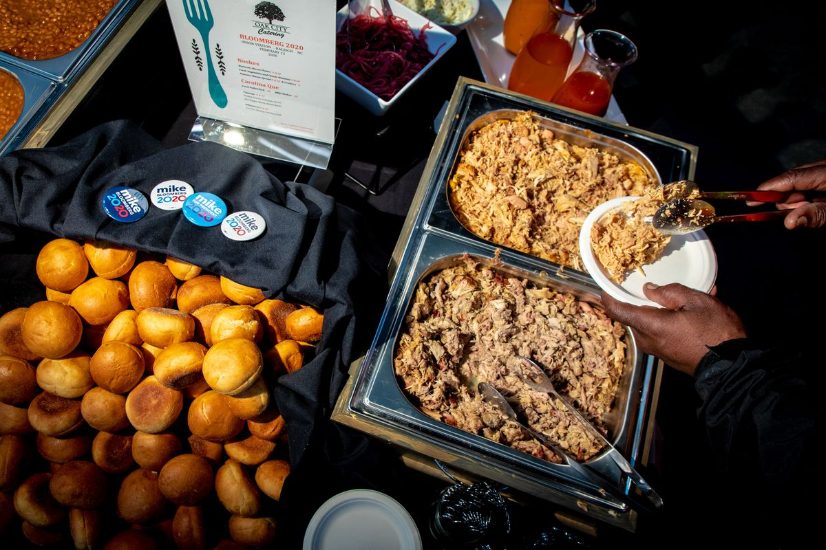 A pulled pork and chicken sandwich station at a Bloomberg rally.