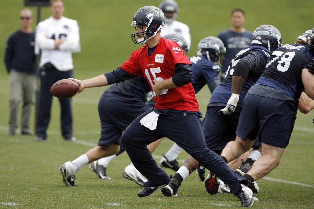 May 30, 2012; Renton, WA, USA; Seattle Seahawks quarterback Matt Flynn (15) participates in an OTA practice at the Virginia Mason Athletic Center. Mandatory Credit: Joe Nicholson-US PRESSWIRE