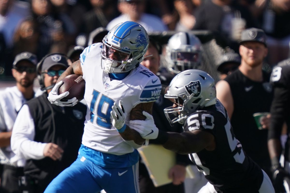 Detroit Lions wide receiver Kenny Golladay runs the football against Oakland Raiders linebacker Nicholas Morrow during the first quarter at Oakland Coliseum.