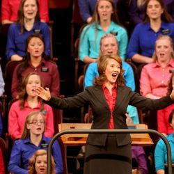 Emily Wadley directs the Relief Society Choir from the Provo Missionary Training Center at the General Relief Society meeting for dhe Church of Jesus Christ of Latter-Day Saints at the LDS Conference Center in Salt Lake City on Saturday, Sept. 28, 2013.