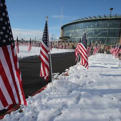 Flags surround the Maverik Center as people arrive for the funeral of Unified police officer Doug Barney at the Maverik Center in West Valley City on Monday, Jan. 25, 2016. Barney was killed in the line of duty on Jan. 17, 2016.