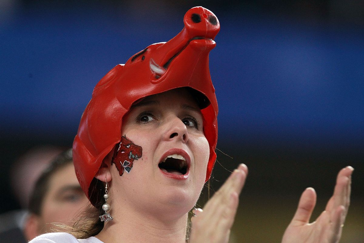 ARLINGTON, TX - JANUARY 06:  A fan of the Arkansas Razorbacks cheers against the Kansas State Wildcats during the Cotton Bowl at Cowboys Stadium on January 6, 2012 in Arlington, Texas.  (Photo by Ronald Martinez/Getty Images)