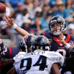 Houston Texans quarterback Matt Schaub (8) throws a pass over Jacksonville Jaguars defensive end Jeremy Mincey (94) and defensive end Tyson Alualu (93) during the second half an NFL football game, Sunday, Sept. 16, 2012, in Jacksonville, Fla. Houston won 27-7.