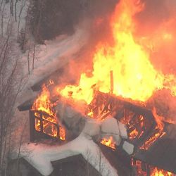 Unified fire crews battle a massive blaze at a cabin near Silver Fork Lodge in Big Cottonwood Canyon on Tuesday, March 1, 2016.