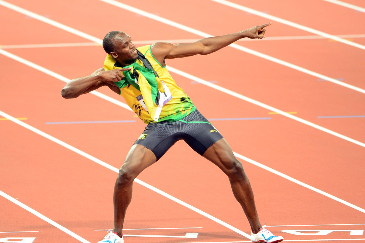 Usain Bolt points west to Pensacola, home of the only man faster than him.  Mandatory Credit: James Lang-USA TODAY Sports