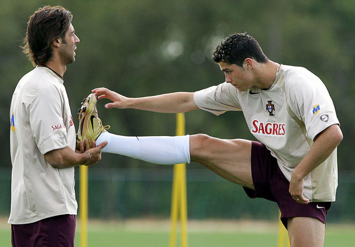 Portuguese player Rui Costa (L) and Cri
