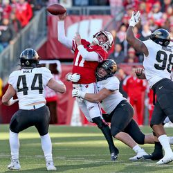 Badgers QB Jack Coan gets hit while attempting a pass. Coan was 15 of 19 attempts (to six different receivers) for 203 yards and 2 TDs.