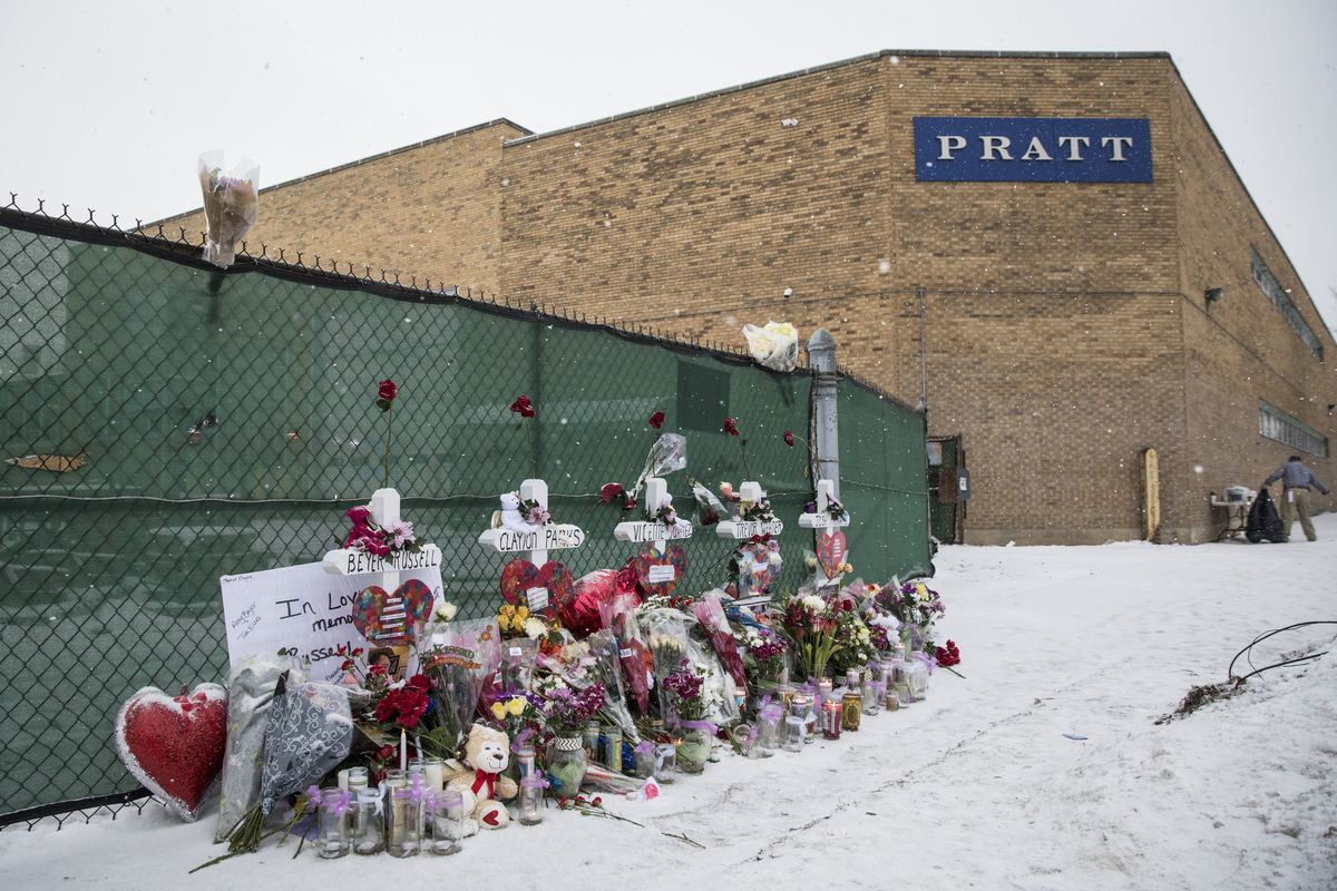 Memorials outside the Henry Pratt Co. in Aurora, Sunday afternoon, Feb. 17, 2019. Five people were killed in a mass shooting at the company two days earlier.