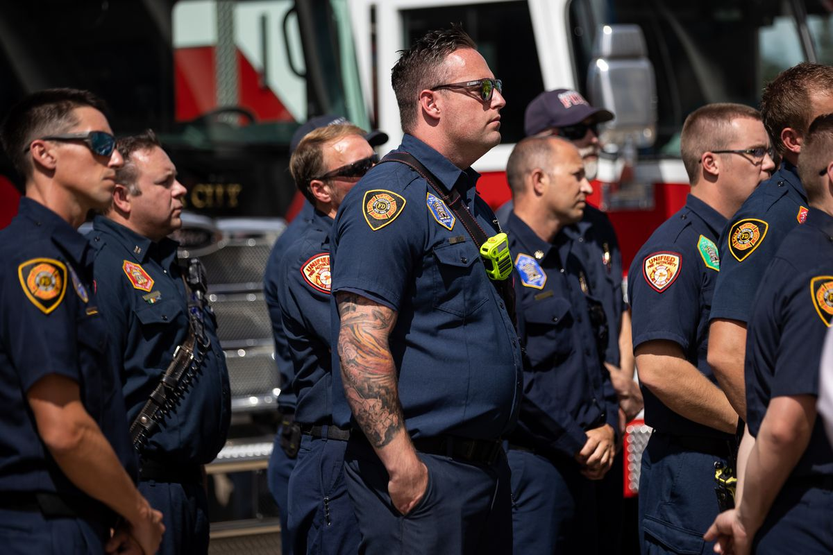 Salt Lake and Unified firefighters listen during a press conference discouraging the use of personal fireworks at the Capitol in Salt Lake City on Wednesday, June 30, 2021.