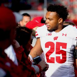 Eric Burrell celebrates the victory with Badger fans. Burrell was second on the team with 6 tackles including one TFL.