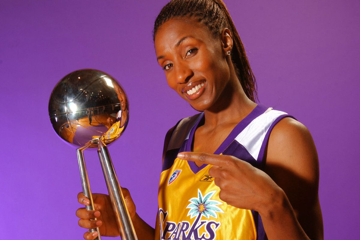 Lisa Leslie poses with the Championship trophy