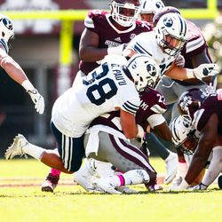 BYU linebacker Butch Pau'u tackles Mississippi State running back Aeris Williams during the first half at Davis Wade Stadium in Starkville, Miss., on Saturday, Oct. 14, 2017.