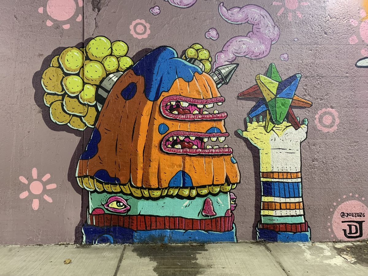 """Chicago artist Joey D. says this mural is """"a direct reference to 'Willy Wonka and the Chocolate Factory' and the everlasting gobstopper. The colors and patterns I used are also vintage-inspired. There are also references to psychedelics and viewing the world and the self through another lens."""""""