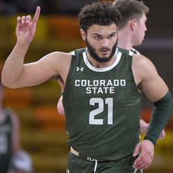 Colorado State guard David Roddy celebrates after making a basket during the second half of the team's NCAA college basketball game against Utah State, Thursday, Jan. 21, 2021, in Logan, Utah.