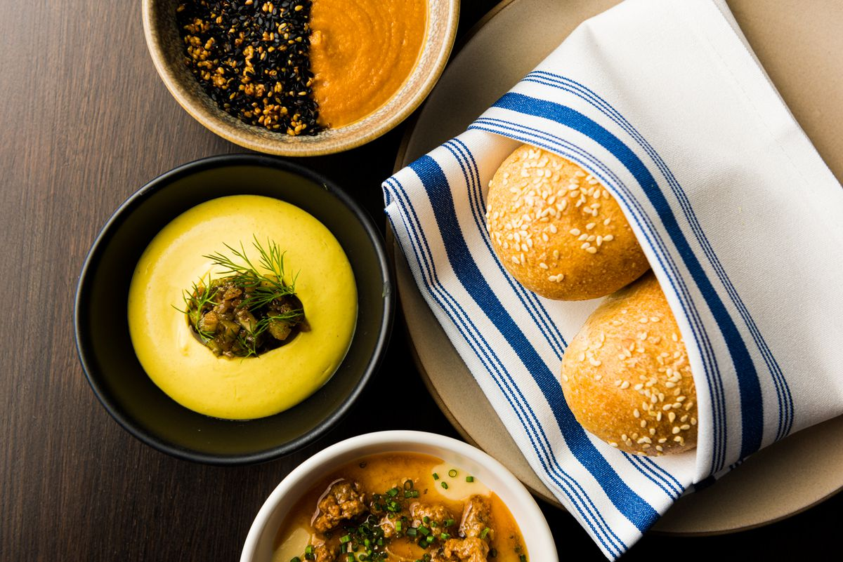 Butter bean, cauliflower curry, and chickpea saffron spreads with Moroccan bread