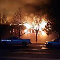 Firefighters battle a large blaze at the Sandy Public Works Building early Friday, Jan. 26, 2017.