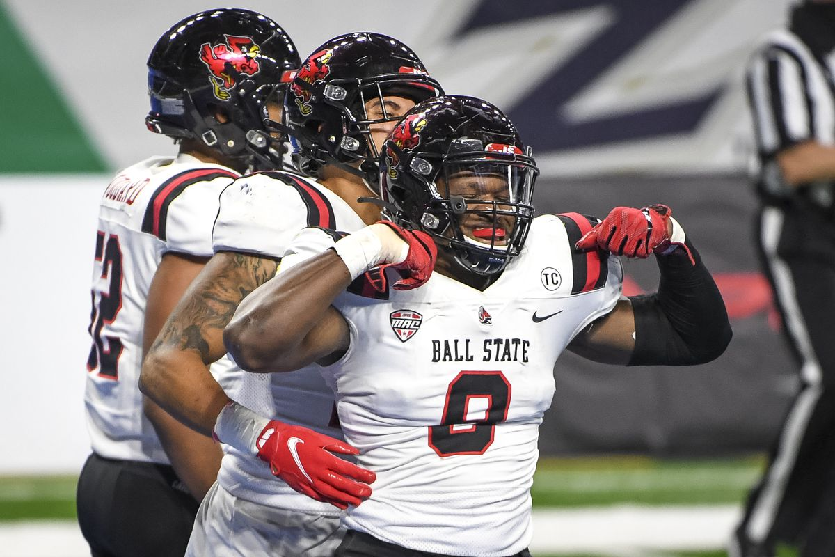 Christian Albright of the Ball State Cardinals celebrates after recovering a fumble for a touchdown against the Buffalo Bulls at Ford Field on December 18, 2020 in Detroit, Michigan.