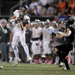 Skyridge's Andrew Buckland comes up with an interception ahead of Corner Canyon's Cole Hagen during a high school football game at Corner Canyon in Draper on Friday, Sept. 24, 2021. Corner Canyon won 38-23.