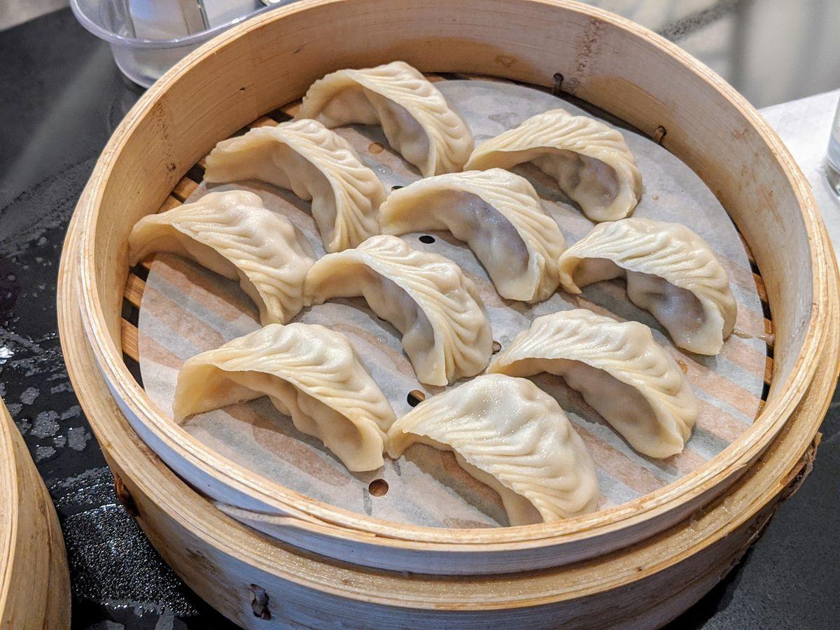A steamer full of pleated dumplings