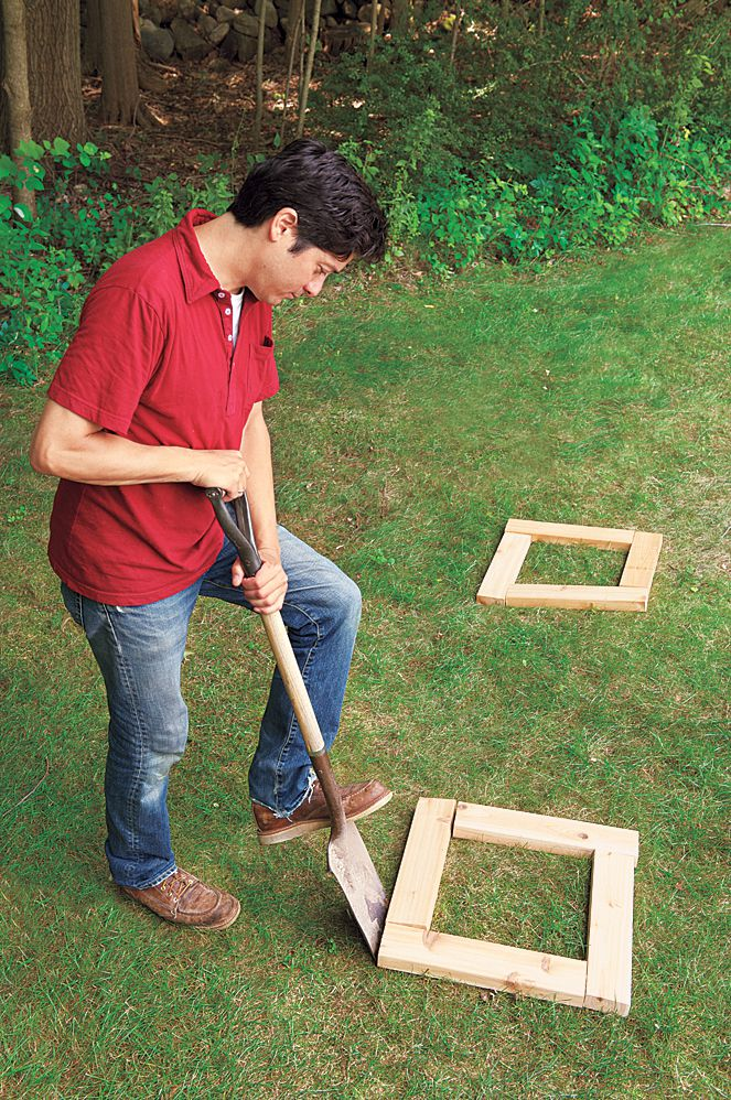 Man Uses Garden Spade To Dig Up Base For Planter Bench