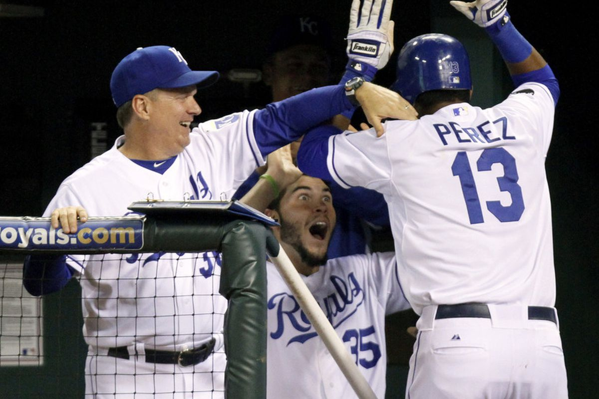 Here's Kevin Seitzer missing a high five as part of his new job as the Royals' hitting coach.