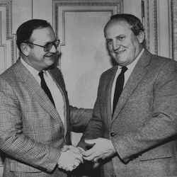 BYU head football coach LaVell Edwards shakes hands with Michigan coach Bo Schembechler prior to the Holiday Bowl in December 1984.