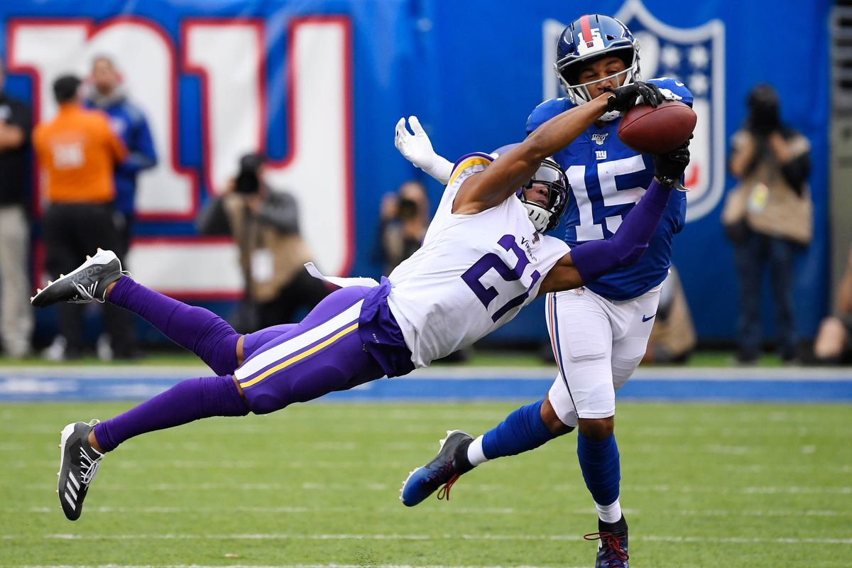 Minnesota Vikings cornerback Mike Hughes breaks up a pass intended for New York Giants wide receiver Golden Tate in the first half at MetLife Stadium.