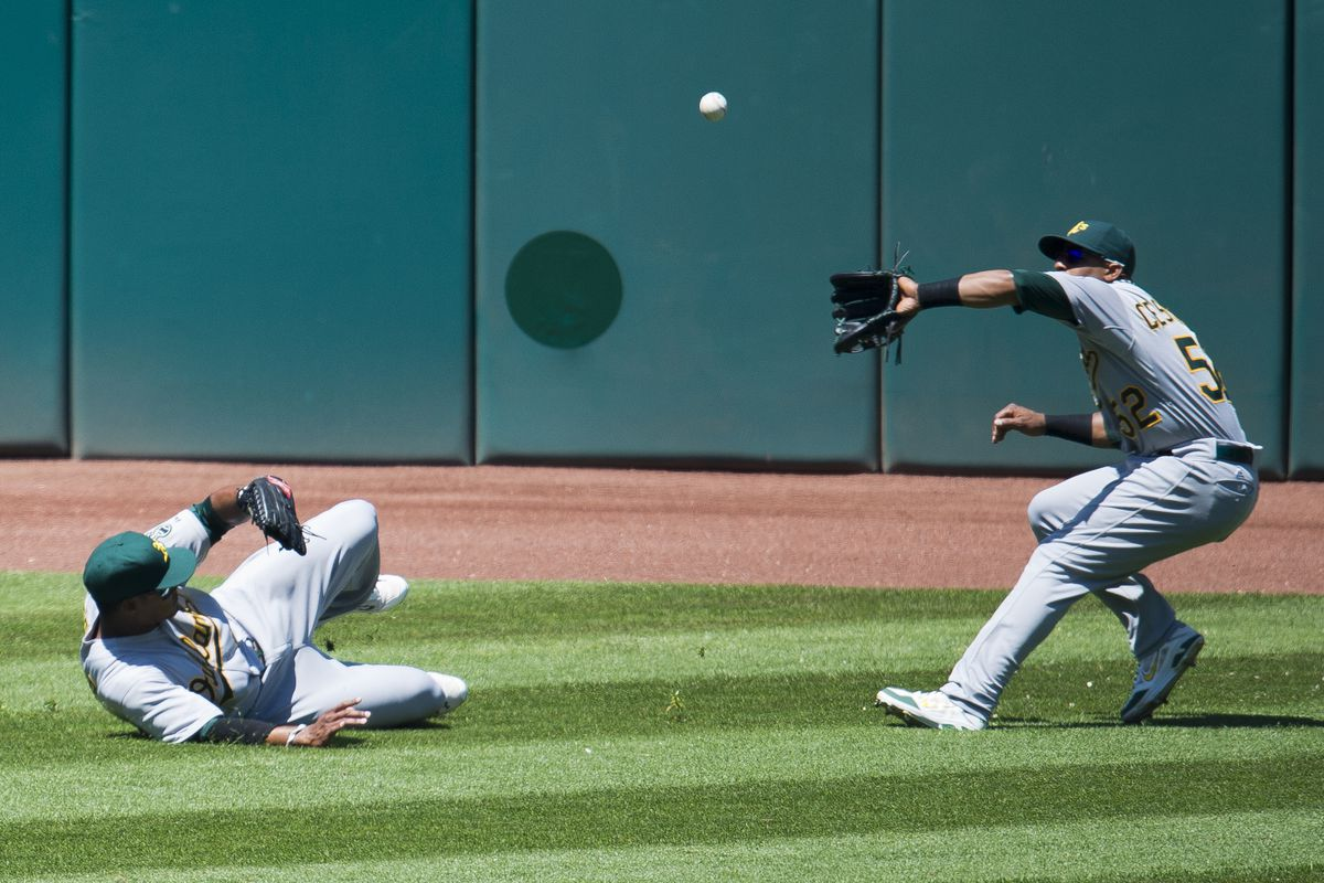 Not surprising: Yoenis Cespedes closes in on the ball as Michael Taylor slides in pursuit of the shadow.