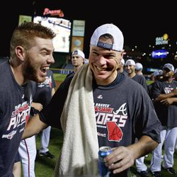 In this photo taken Sept. 25, 2012, Atlanta Braves' Chipper Jones, right, celebrates with teammate Freddie Freeman after the Braves beat the Miami Marlins 4-3 in a baseball game in Atlanta, to clinch a playoff spot. With one last trip to the postseason assured, Jones is relishing the final days of his last season. Jones, who will be honored by the Braves before Friday night's game against the Mets, says he is savoring the final days of his last regular season as he and his teammates look forward to the playoffs.