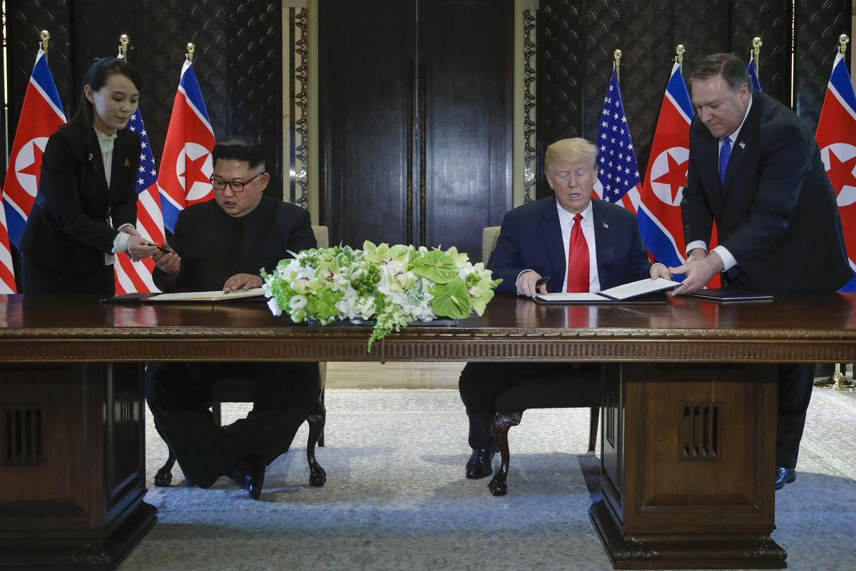 President Donald Trump And North Korean Leader Kim Jong Un Prepare To Sign A Document At A Ceremony Marking The End Of Their Historic Nuclear Summit At The