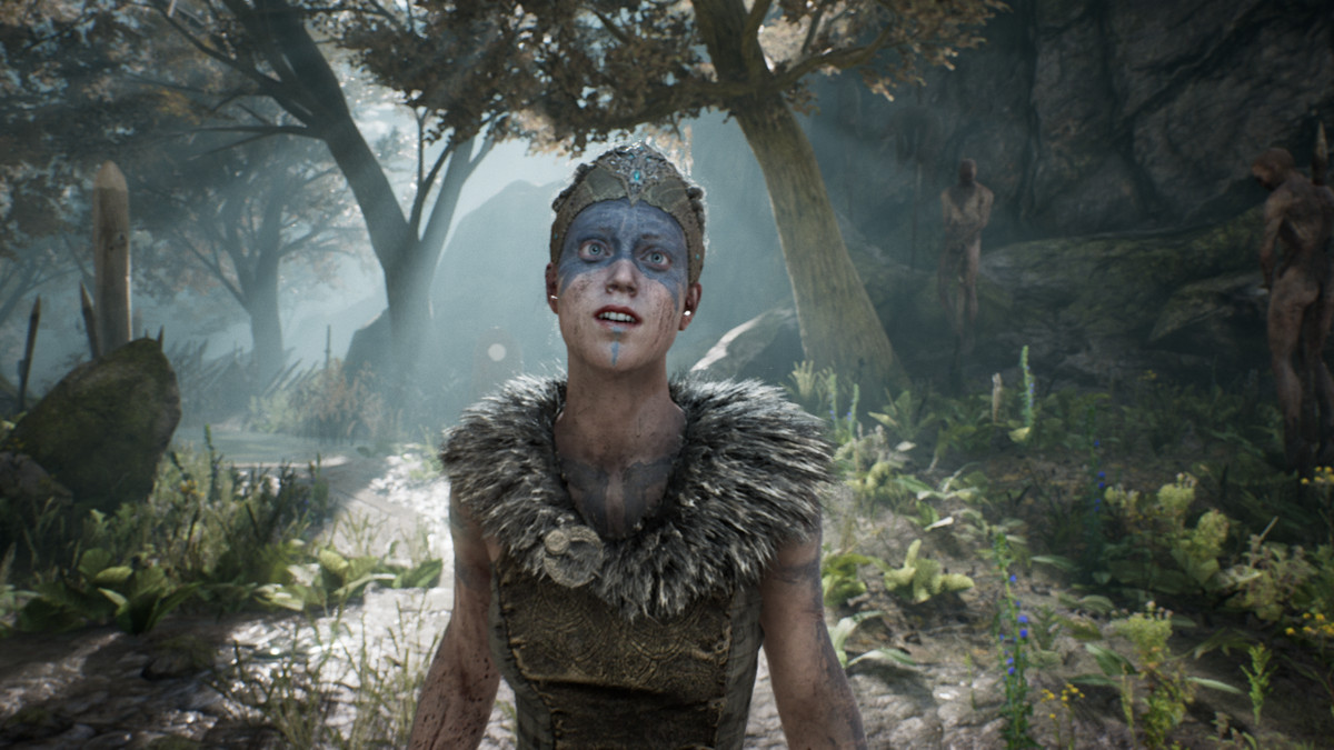 Hellblade's protagonist, Senua, stands in a forest