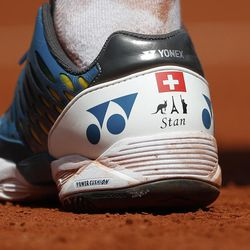 Switzerland's Stan Wawrinka's shoes sport his name and images of a Wallaby, the Eiffel Tower and the Statue of Liberty for the three places he won Grand Slam titles, as he plays against Britain's Andy Murray during their semifinal match of the French Open tennis tournament at the Roland Garros stadium, in Paris, France. Friday, June 9, 2017.