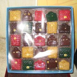MarieBelle purse chocolate ganache set, $50
