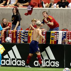 Real Salt Lake midfielder Albert Rusnak (11) tosses his jersey to fans as he exits the game as Real Salt Lake and Vancouver FC play at Rio Tinto Stadium in Sandy on Wednesday, July 7, 2021. RSL won 4-0.