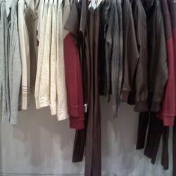 Some mens cardigans, sweaters, and pants.