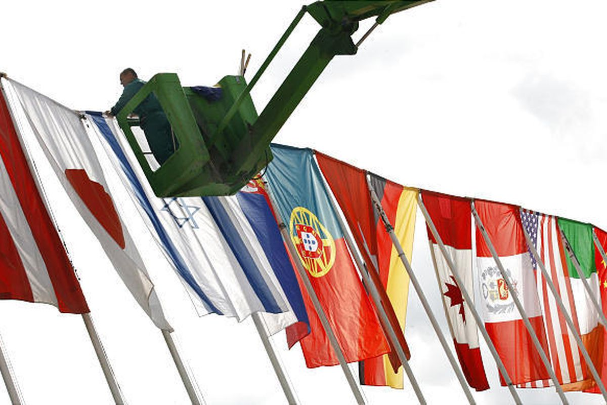 A Bosnian worker puts up flags of the countries that will participate in the 15th Sarajevo Film Festival  in Sarajevo. A total of 232 movies from 53 countries will be presented during the festival, which began Wednesday.