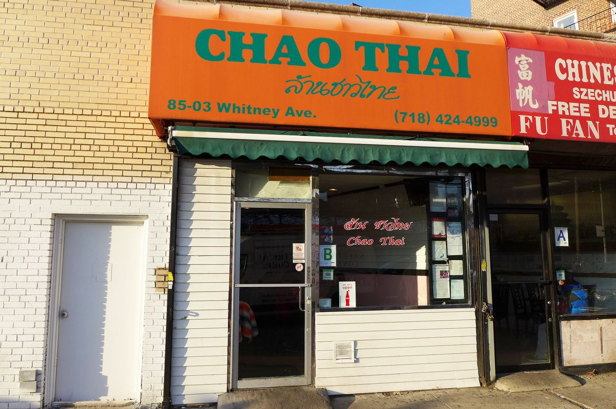 A storefront with an orange awning saying Chao Thai