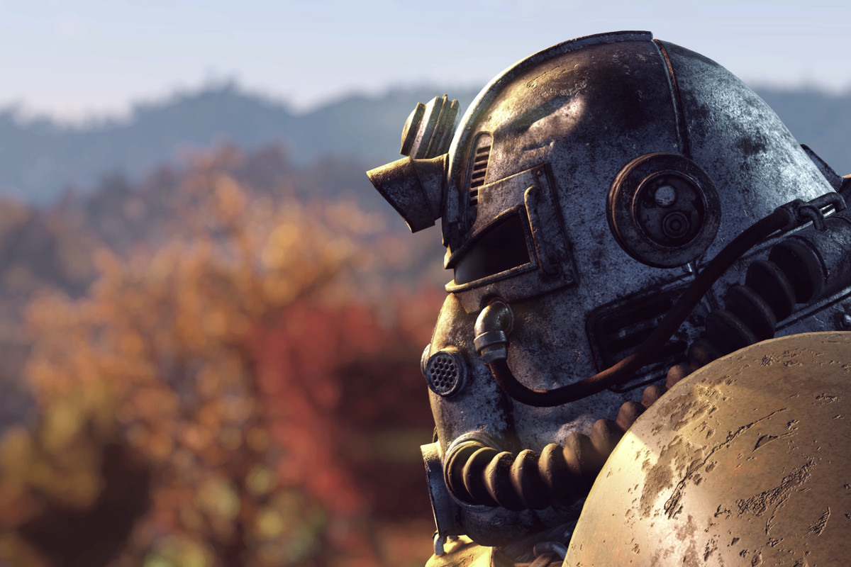 Fallout 76 - profile of power armor helmet with autumn trees in the background